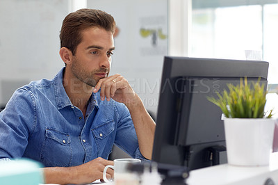 Buy stock photo Cropped shot of a businessman working on his computer