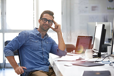 Buy stock photo Portrait of a handsome businessman sitting at his desk