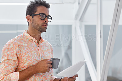 Buy stock photo Cropped shot of a businessman going over some paperwork
