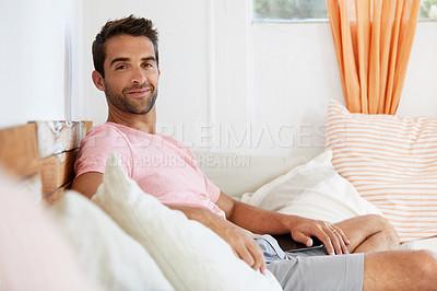 Buy stock photo Shot of a man in his home