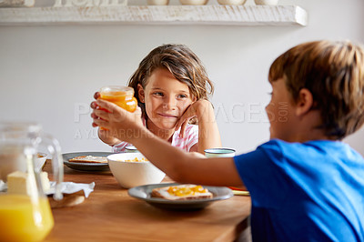 Buy stock photo Cropped shot of siblings having breakfast together at home