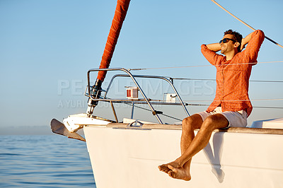Buy stock photo Shot of a young man going for an ocean cruise on a boat
