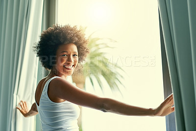 Buy stock photo Cropped shot of an attractive young woman opening the curtains in her bedroom at home