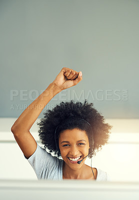 Buy stock photo Cropped portrait of an attractive young businesswoman cheering while working in a call center