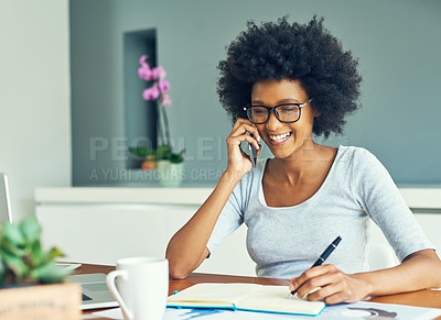 Buy stock photo Cropped shot of an attractive young businesswoman working at home
