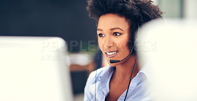 Buy stock photo Shot of an attractive young woman working in a modern call centre