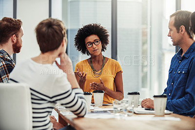 Buy stock photo Shot of creative employees working in a modern office