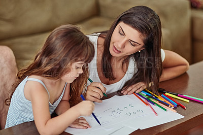 Buy stock photo Shot of a young woman drawing together with her young daughter at home
