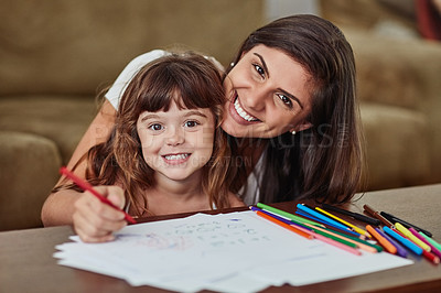 Buy stock photo Portrait of a young woman drawing together with her young daughter at home