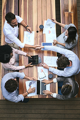 Buy stock photo High angle shot of a team of businesspeople having a meeting outside