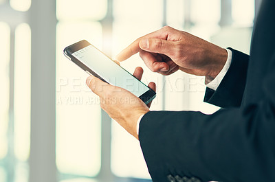 Buy stock photo Cropped shot of corporate businessmen texting on a cellphone