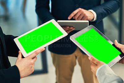 Buy stock photo Cropped shot of a group of businesspeople using their digital tablets during a collaboration