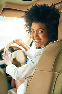 Buy stock photo Portrait of a cheerful young businesswoman driving in a car on her way to work during the day