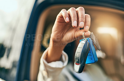 Buy stock photo Closeup of an unrecognizable businessperson holding a set of keys while being seated inside of a car during the day