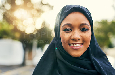Buy stock photo Portrait of a cheerful young woman standing alone and smiling to the camera  outside during the day