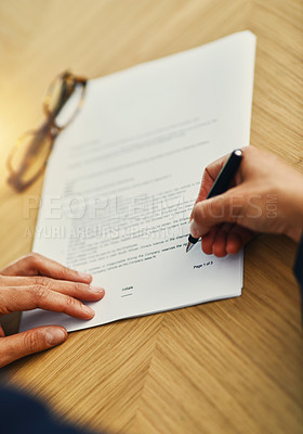 Buy stock photo Closeup shot of an unrecognizable businesswoman completing paperwork at a desk