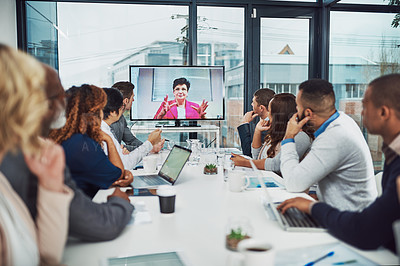 Buy stock photo Cropped shot of a group of white collar businesspeople meeting in the boardroom