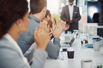 Buy stock photo Cropped shot of a group of businesspeople applauding during a meeting in the boardroom
