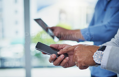 Buy stock photo Closeup shot of two unrecognizable businessmen using digital devices in an office