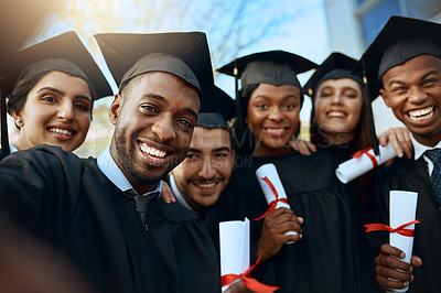 Buy stock photo Portrait of a group of students taking selfies on graduation day
