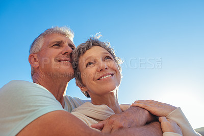 Buy stock photo Shot of an affectionate mature couple enjoying a day outdoors