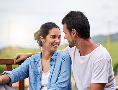 Buy stock photo Cropped shot of an affectionate young couple spending time together outdoors