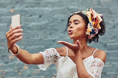 Buy stock photo Cropped shot of an attractive young woman taking a selfie against a brick wall outside