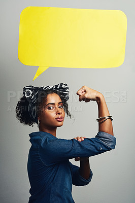Buy stock photo Studio shot of an attractive young woman posing with a speech bubble against a grey background