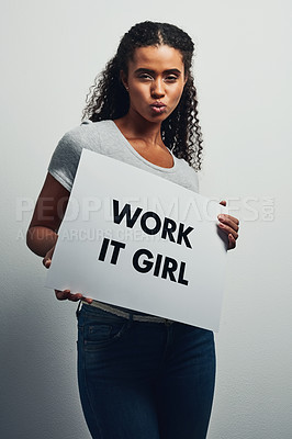 Buy stock photo Studio shot of an attractive young woman holding a placard that reads