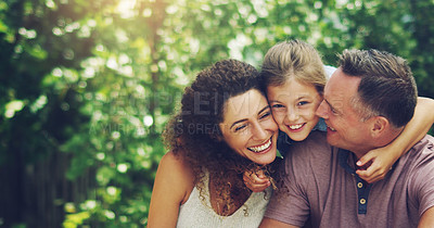 Buy stock photo Portrait of an affectionate little girl spending quality time with her mother and father outdoors