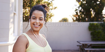 Buy stock photo Shot of a beautiful young woman getting ready for a workout at home