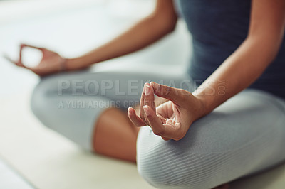 Buy stock photo Shot of an unrecognizable woman practicing yoga at home