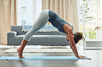 Stretching her slim body with yoga