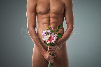 Buy stock photo Studio shot of an unrecognizable shirtless man holding a bunch of flowers against a grey background