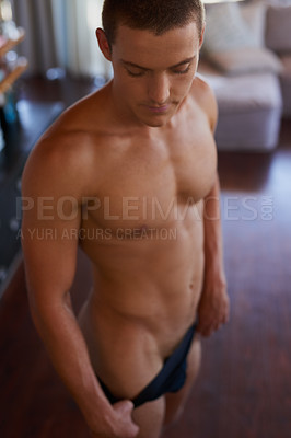 Buy stock photo Cropped shot of a handsome and shirtless young man at home