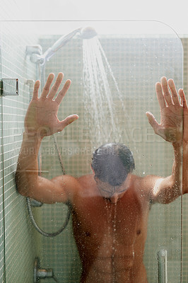 Buy stock photo Cropped shot of a handsome young man having a refreshing shower at home