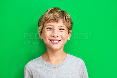 Buy stock photo Studio portrait of a young boy standing against a green background