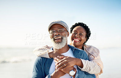 Buy stock photo Portrait of a mature couple enjoying some quality time together at the beach