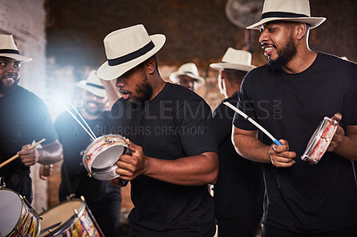 Buy stock photo Shot of a group of musical performers playing together