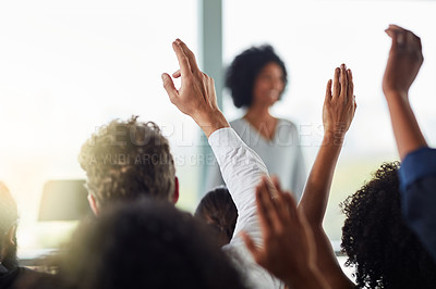 Buy stock photo Rearview shot of a group of businesspeople with their hands raised during a seminar