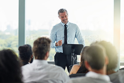 Buy stock photo Cropped shot of a handsome mature businessman speaking at a business conference