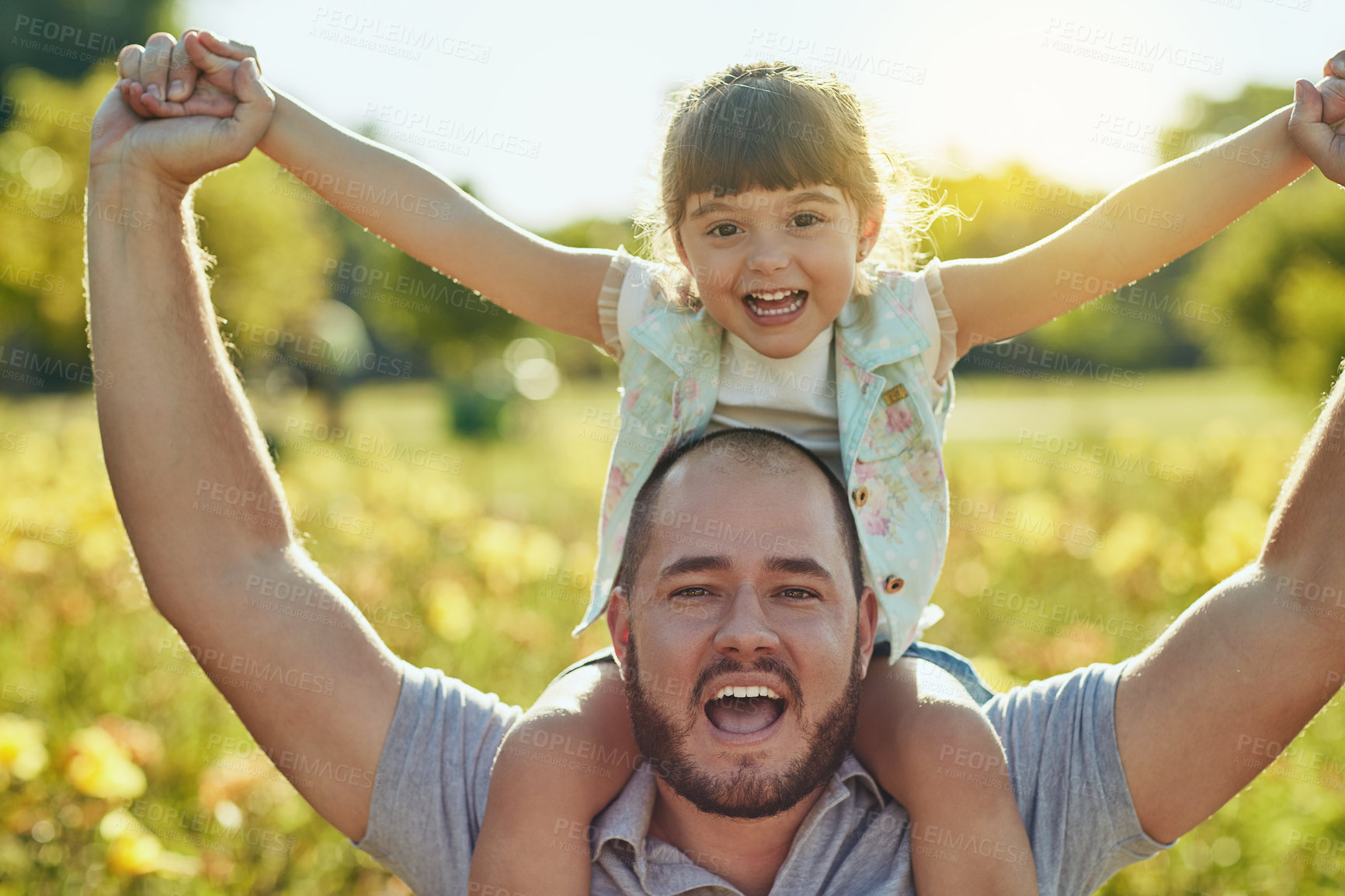 Buy stock photo Shot of an adorable little girl and her father playing together in the park