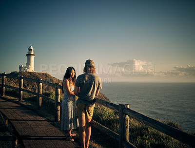 Buy stock photo Shot of a young couple spending some quality time along the coast