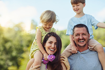 Buy stock photo Portrait of a happy family bonding together outdoors