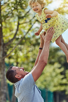 Buy stock photo Shot of a father bonding with his little daughter outdoors