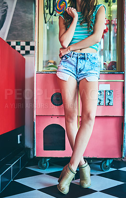 Buy stock photo Cropped shot of an unrecognizable young woman standing in a retro diner