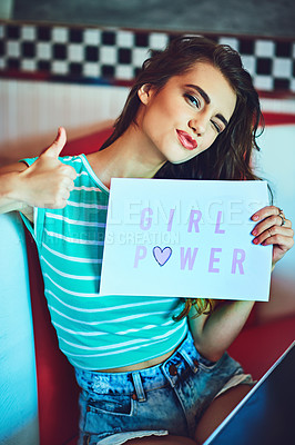 Buy stock photo Cropped portrait of an attractive young woman holding up a sign in a retro diner