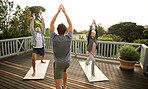 The instructor helps them perfect their yoga poses