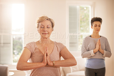 Buy stock photo Cropped shot of a senior woman practicing yoga with a female instructor at home