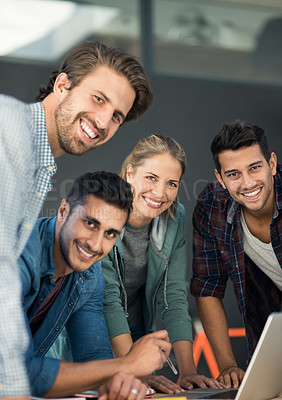 Buy stock photo Portrait of a group of designers working together on a laptop in an office